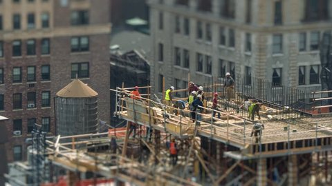 Construction workers working on building site in Manhattan, NYC, NY. 4K UHD Timelapse.
