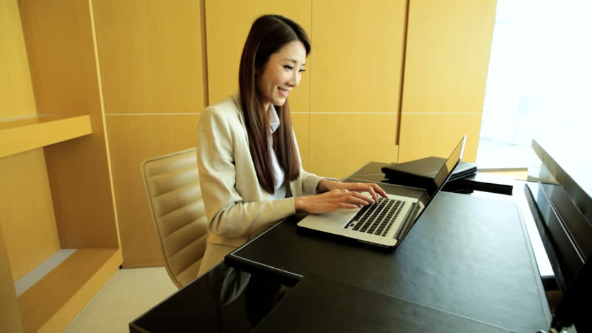 Female Asian Chinese American corporate business traveller luxury hotel accommodation wireless laptop technology meeting information conference | Shutterstock HD Video #7838848