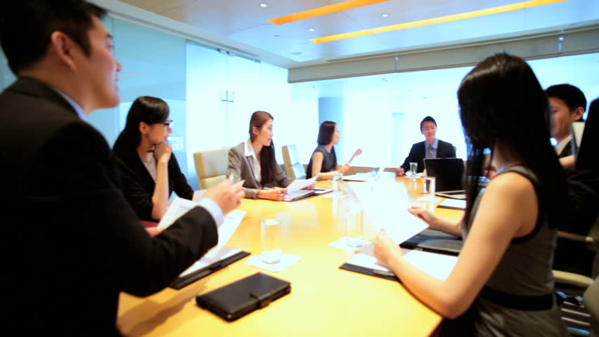 Successful team young Asian Chinese American business finance consultants boardroom conference China wireless computer technology device | Shutterstock HD Video #7852117