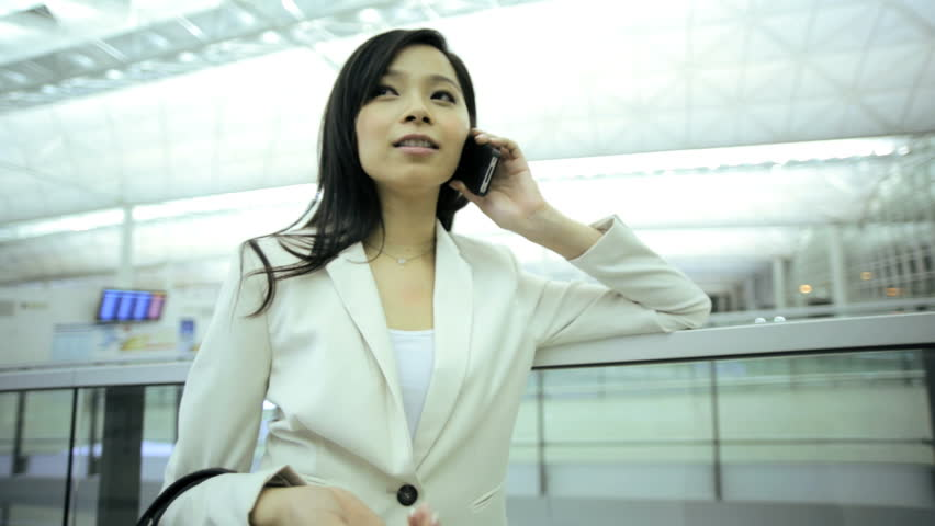 Wireless cloud smart phone email communications young ethnic smart female business traveller airport terminal conference meeting | Shutterstock HD Video #7853866