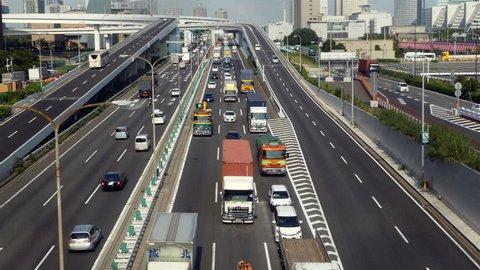 Tokyo Japan - Circa September 2014 Time Lapse of Heavy Truck Traffic on Japanese Highway -   Tokyo Japan Circa September 2014