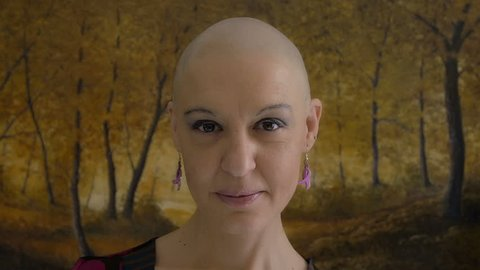 Happy and young cancer survivor after successful chemotherapy: courage, hope