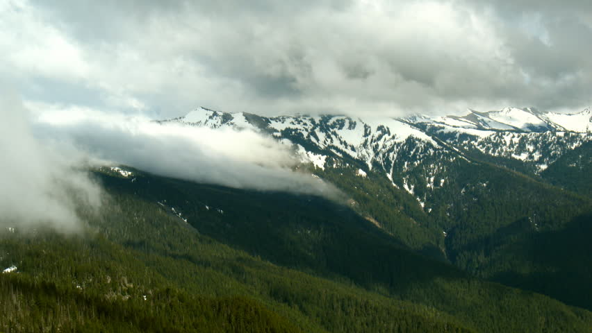 Time lapse of fog rolling over a mountain chain in Olympic National Park.  3 treatments of the footage; 2 static, 1 slow zoom/pan. | Shutterstock HD Video #787738
