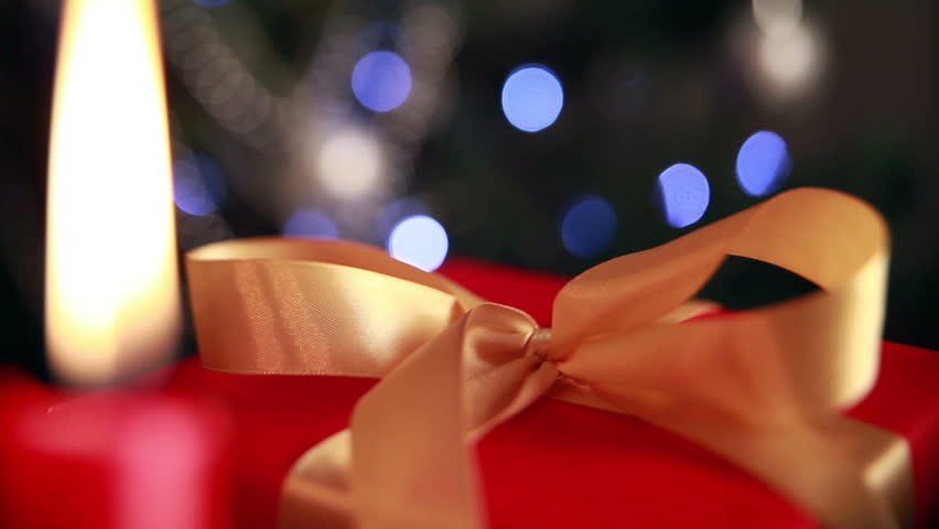 Christmas theme. Christmas gift with candles and twinkling lights. | Shutterstock HD Video #7923328