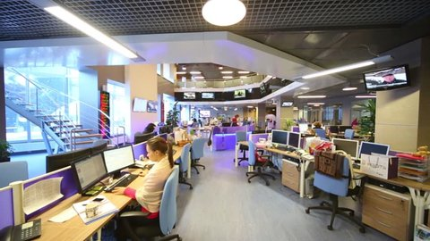 MOSCOW, RUSSIA - MAR 5, 2013: Staff work at computers in big office of RIA Novosti russian news agency
