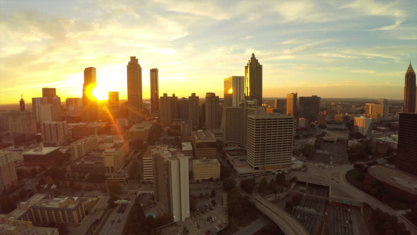 Atlanta aerial flying backwards with cityscape sunset view. #7930492