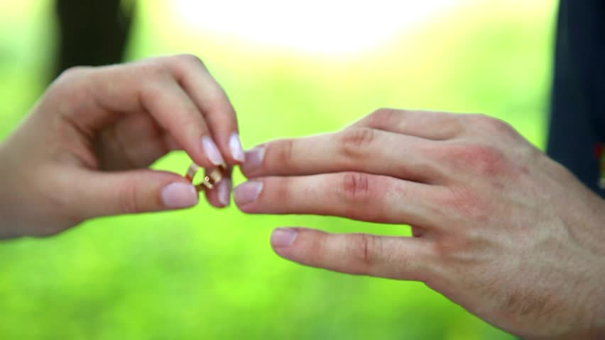 closeup of hands of white bride and groom exchanging wedding rings weddings marriage proposal exchanging
