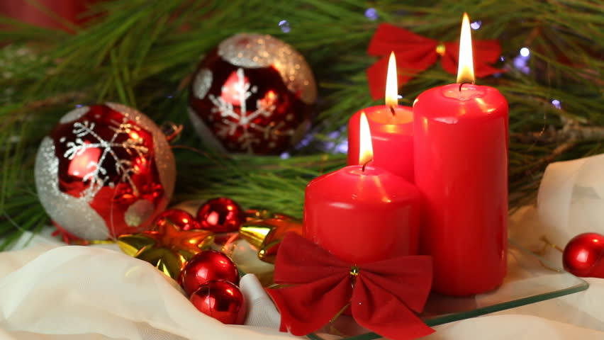 Christmas decoration with red candles and beautiful colorful ornaments