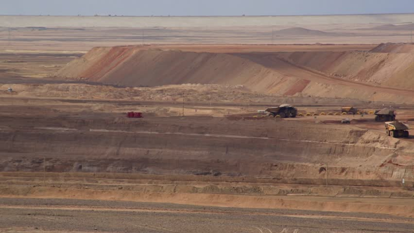 Generic footage of mine. Wide view of the activities of a mine in the middle of the Atacama Desert in Chile.