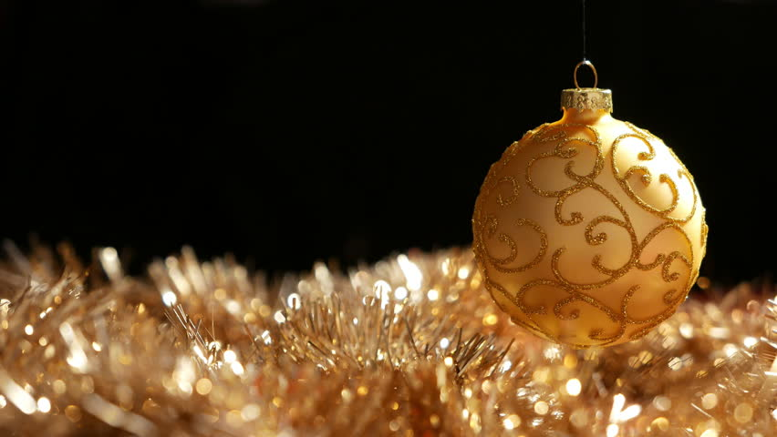 Christmas Gold Ball Spinning Above Golden Glitter, In Front Of ...