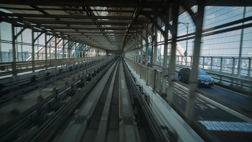 POV shot on the tokyo monorail passing through the city's skyscapers and futuristic style buildings  | Shutterstock HD Video #8035258