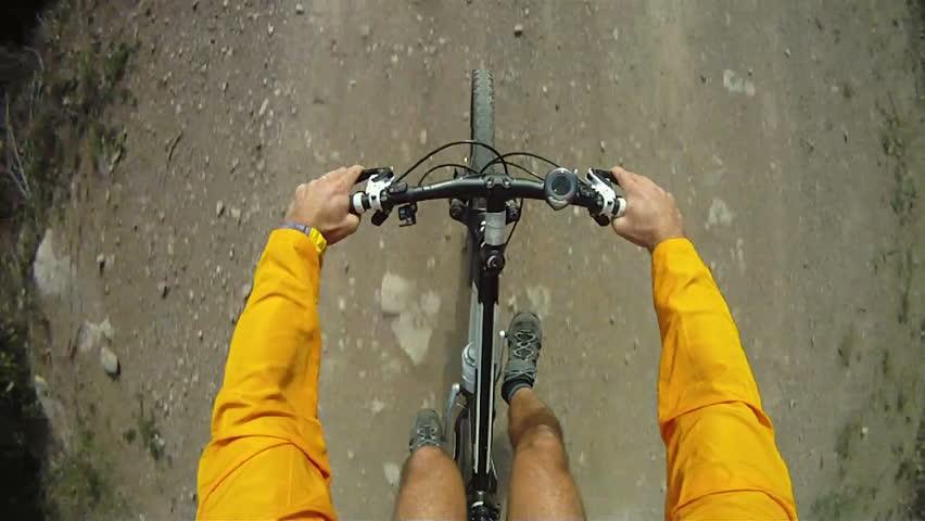 Mountain Bike being ridden along dirt track