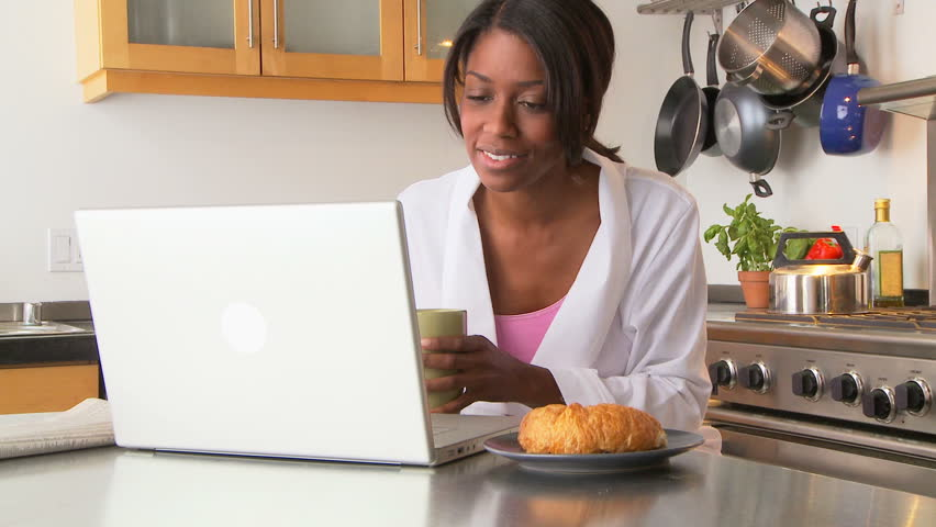 Young woman using laptop in the morning