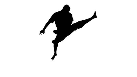 A silhouette of a karate man exercising against white background. Slow motion