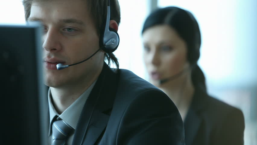 Company representative using headset to talk on the hot line