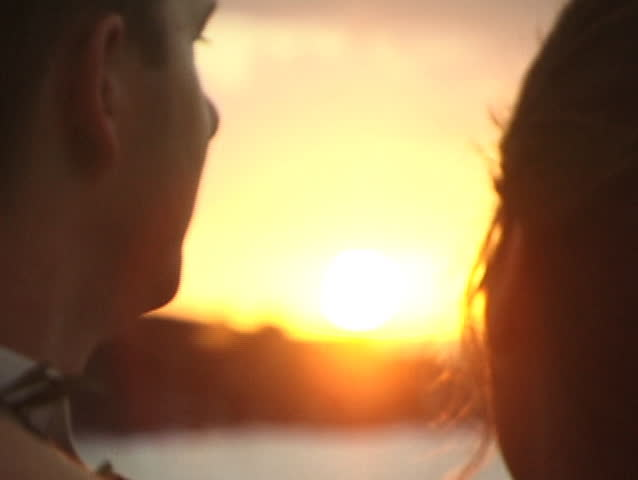 Close up, soft focus of two lovers faces in sunset