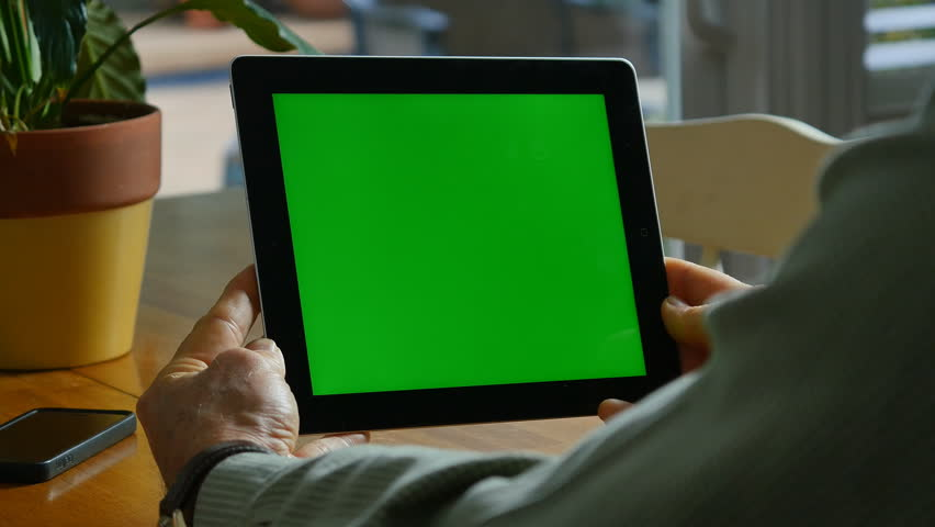 Los Angeles, CA.-  Circa 2014.  An iPad With Green-Screen is Used by a Man. | Shutterstock HD Video #8279188