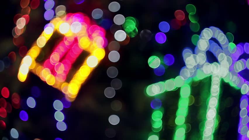 Christmas bokeh. Blinking gift boxes on Chrismas tree out of focus. Source: DSLR, graded. | Shutterstock HD Video #8285218