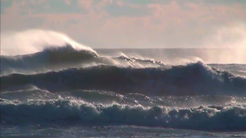 Ocean waves sea spray foam sunset sky slow motion