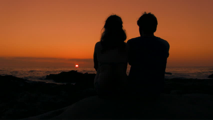 Romantic couple by ocean at sunset V2 - HD