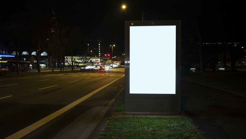 Illuminated blank billboard - in the background traffic. Time lapse at night. Copy space | Shutterstock HD Video #8336656