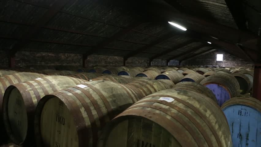 Jib shot of Whisky barrels in a warehouse