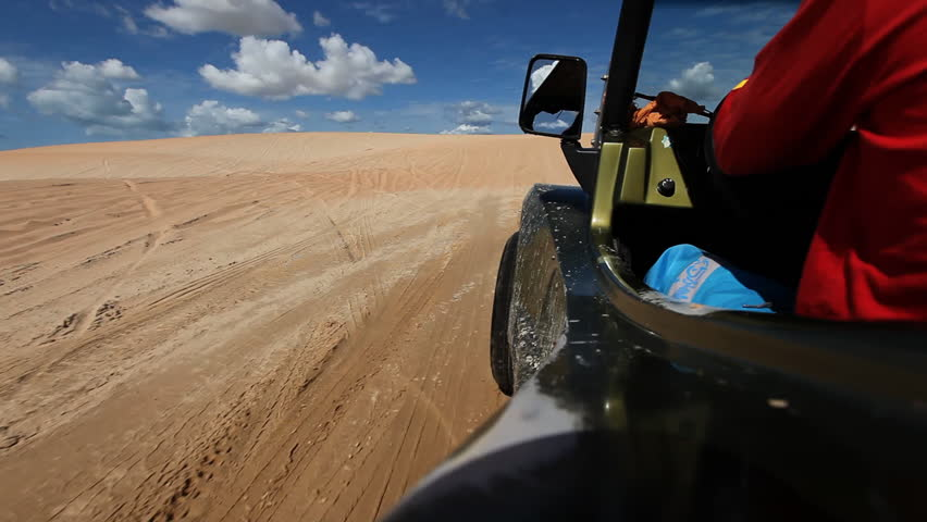 Though ride through sand dunes with a buggy, viewed from vehicle
