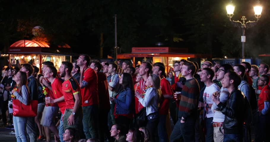 BERLIN, GERMANY - JUNE 30, 2014 Happy Belgians People Crowd Fans Goal Cheer Jubilation Belgium vs USA Round 16 World Cup 2014, Brandenburg Gate Public Viewing ( Ultra HD, UHD, 4K, 2160P, 4096x2160 )
