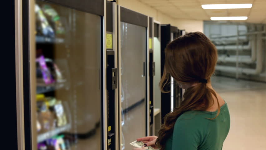 Girl buying a snack from a Vending Machine