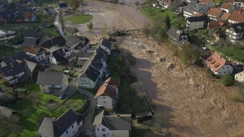 AERIAL: Big river flooding the suburbs after heavy rain