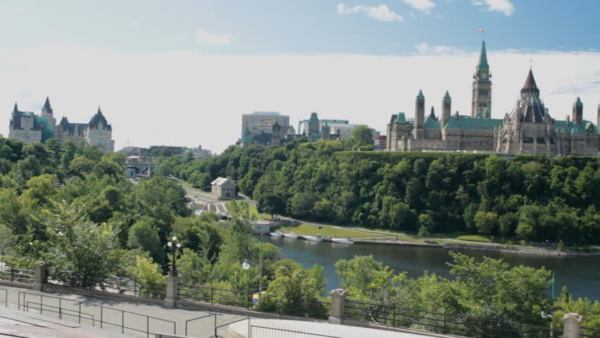 Panning Shot Of The Canadian Parliament Buildings As Seen From The Back At The Champlain Lookout And The Skyline Of Ottawa