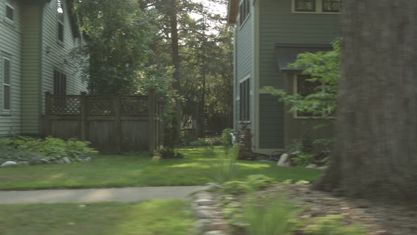 Driving plate: right side (driver) view, upper middle class 1930s and 40s-era homes in an affluent Mid West US neighborhood. Intended for compositing. 24mm lens, stabilized clip, recorded in 4K, UHD