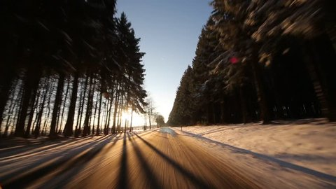 P.O.V. Video footage of Driving on Highway in winter with sun
