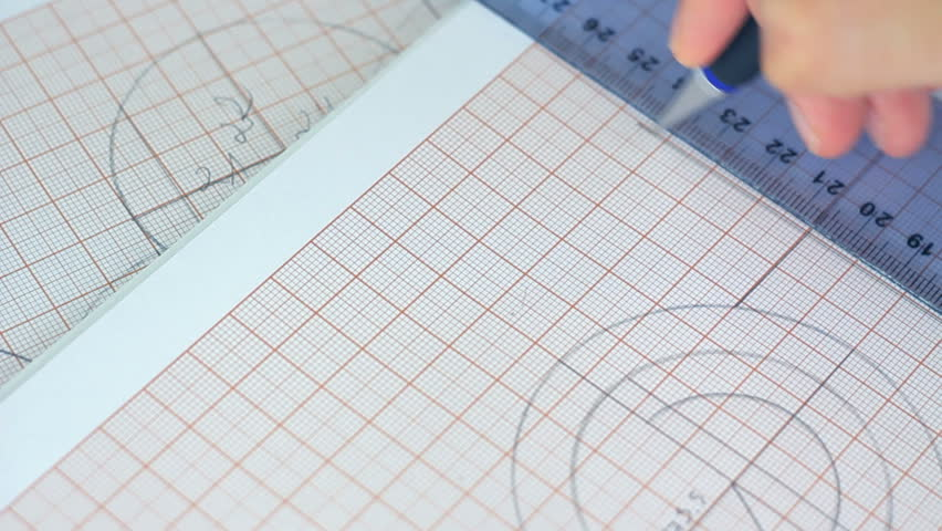 Drawing Lines Using A Ruler Ks1 : Close up of hands drawing lines with pencil on the graph