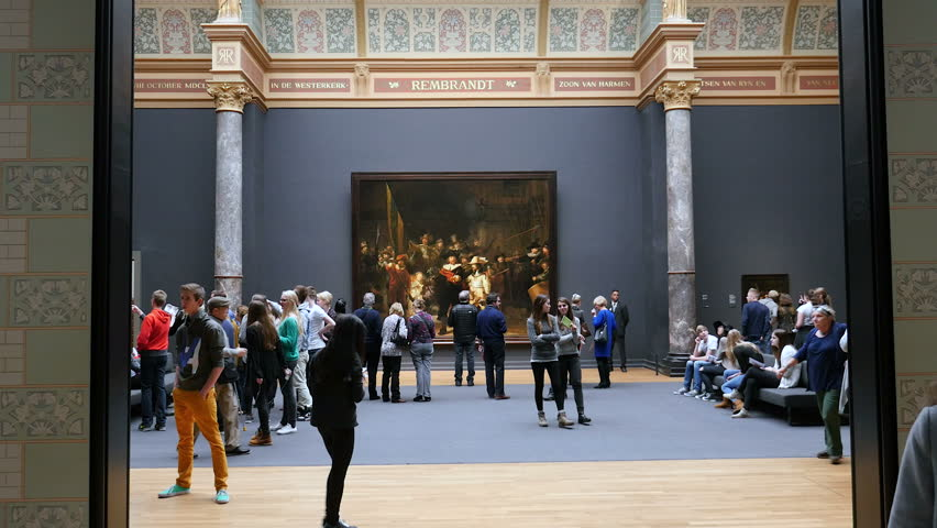 November, 17, 2014. Rijksmuseum, Amsterdam, the Netherlands.The room at the Rijksmuseum in Amsterdam with the world famous Night Watch by Rembrandt and vistors. Wide shot.