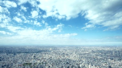 4K aerial time lapse of Tokyo - urban panorama with beautiful clouds / City view from the Sky Tree tower - urban landscape