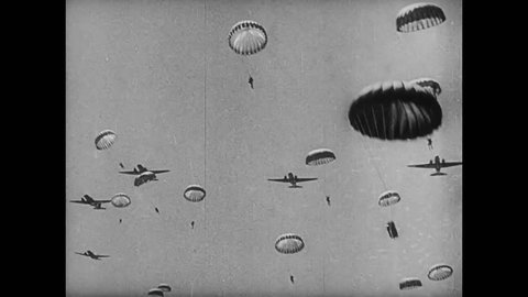 Paratroopers jumping from plane, 1940s