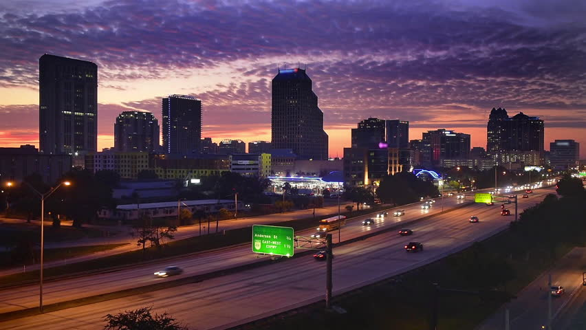Orlando, Florida downtown cityscape over the highway at dawn.