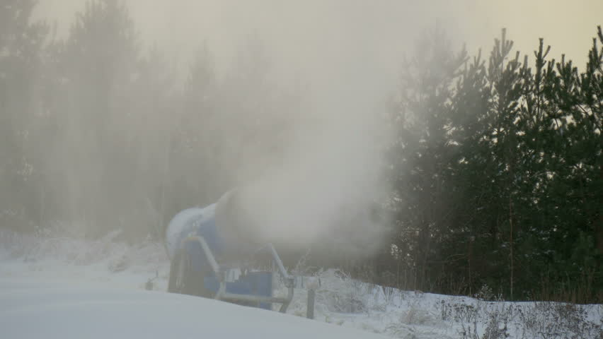 The blowing of snow with the snow blower. There are lots pf pine trees found in the area | Shutterstock HD Video #8546008