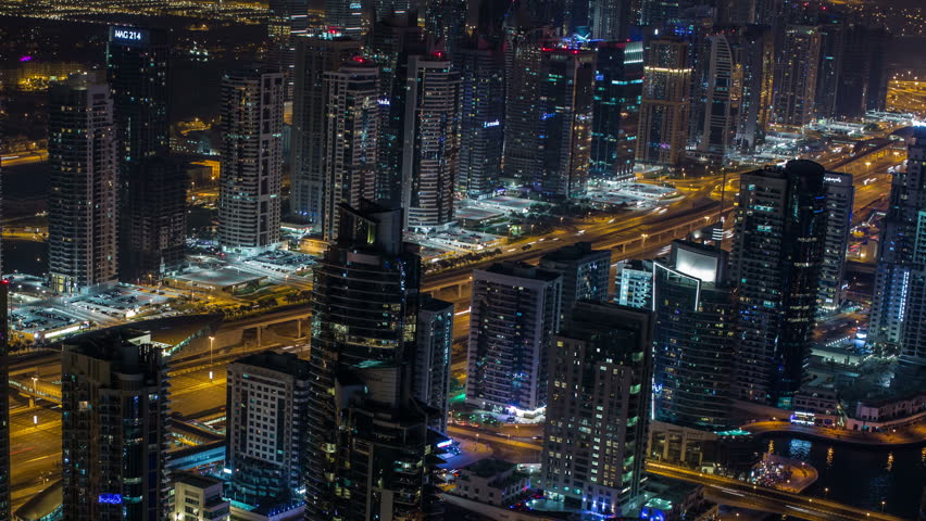 Time lapse photography, Ultra HD 4K aerial view Sheikh Zayed Road with Dubai Marina in United Arab Emirates at night, Photo Sequence shot in RAW, zoom out | Shutterstock HD Video #8557498