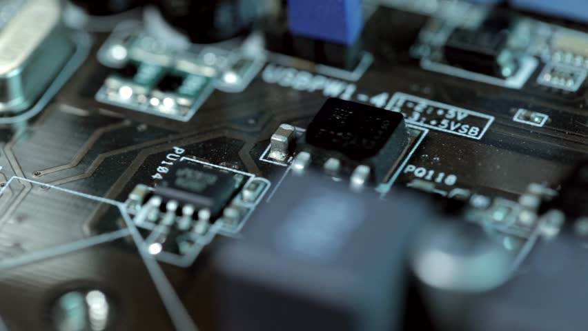 Close up macro on circuit board with radio components. Motherboard. Transistor, IC, capacitor, resistor, diode.   Shutterstock HD Video #8574118
