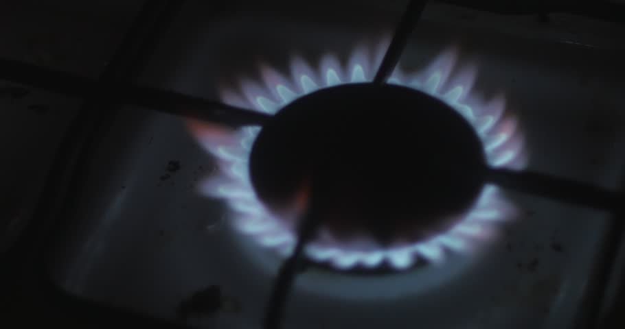 Gas burner stove for cooking, yellow and blue flames, burning gas, paper. The use of oxygen gas is burning, a large flame. The fire in the kitchen burning room. Set fire Night dark  flash fire. #8594698