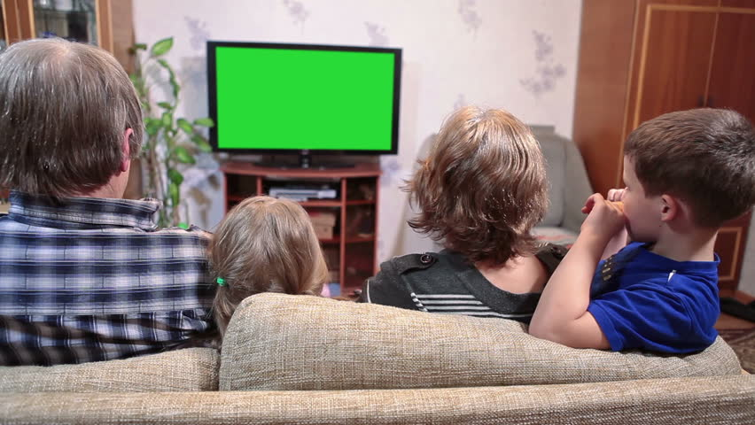 kids watching tv. four people family watching tv with green screen, siting sofa together, parents two children stock footage video 8628418 | shutterstock kids o