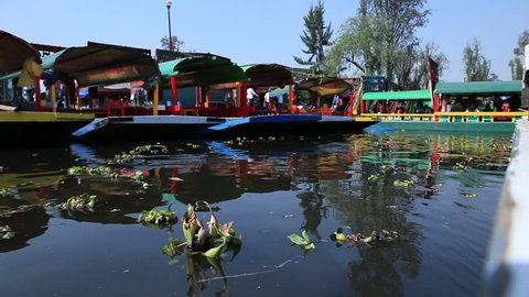 "Xochimilco, Mexico City, traveling in a ""trajinera"" boat along the river."