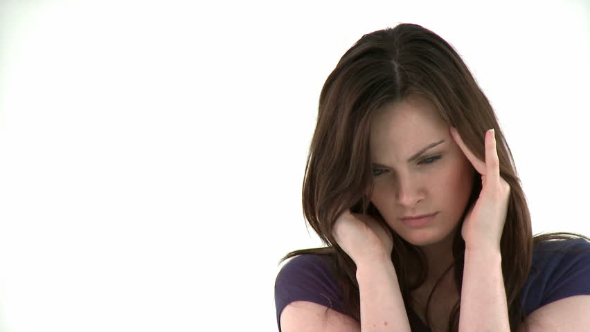 stressed woman having a headache against white background - HD stock video  clip