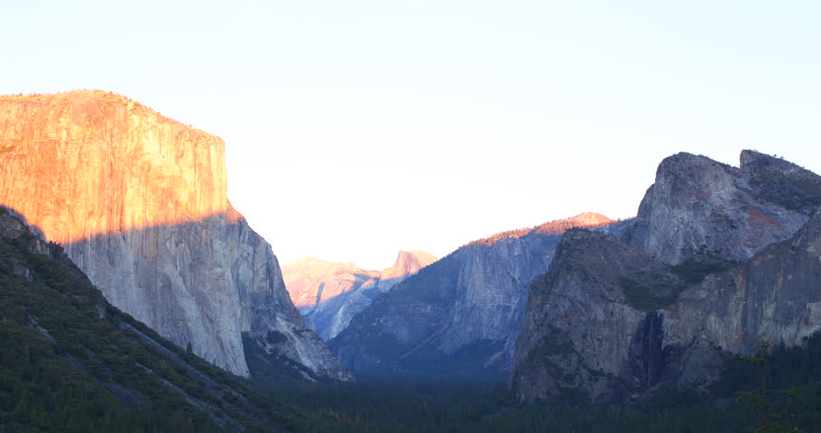 Time lapse of Yosemite Valley from tunnel viewpoint during sunset. Yosemite National Park, California is visited by over 3.7 million tourists yearly. Shot on Red Epic.