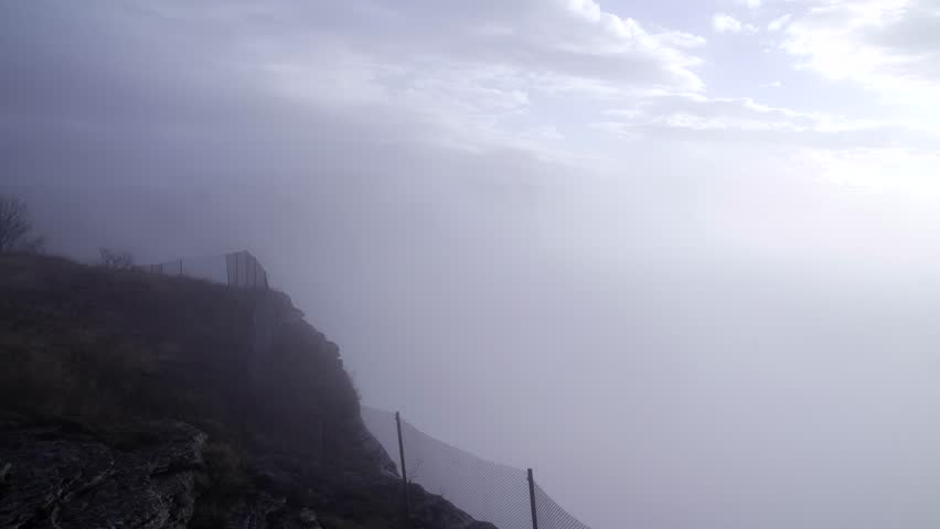 View from a mountain with fog,clearing #8706949