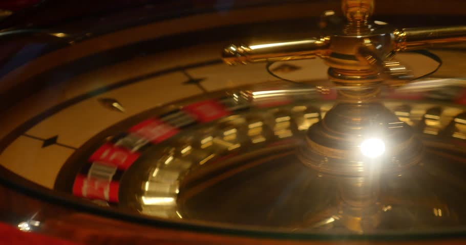 Close up shot of a casino roulette in motion-the shot moves from the left side to the right/The plague of the 21st century