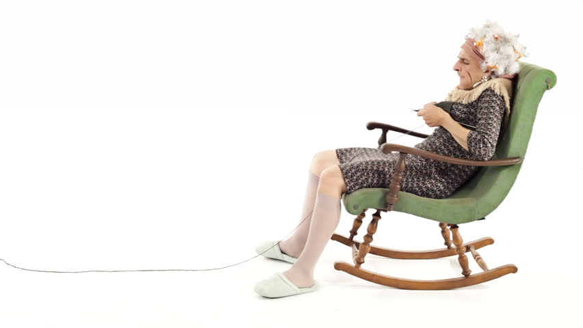 Senior woman knitting in rocking chair stock footage video