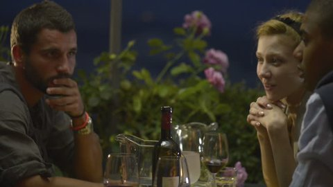 Friends in summer day evening are chattering at italian restaurant - HD video footage